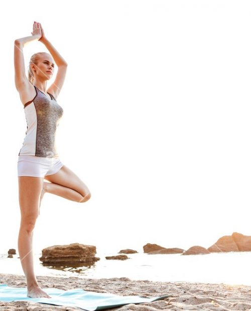 graphicstock-portrait-of-a-young-woman-standing-in-yoga-pose-on-one-leg-on-beach_SOGgWhiSnl_SB_PM